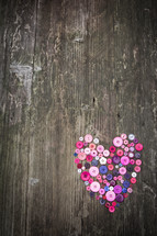 heart in buttons on a wood background