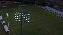 aerial view over soccer practice in a stadium