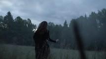a woman running through a foggy field