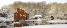 Snow and a mill in winter. The historic Red Mill in Clinton, NJ