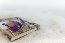 sunglasses on a notebook
