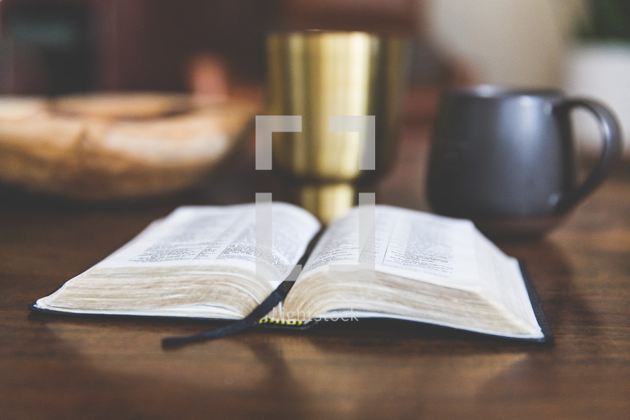 a Bible on a wood table