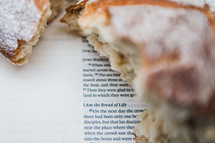 communion bread on the pages of a Bible