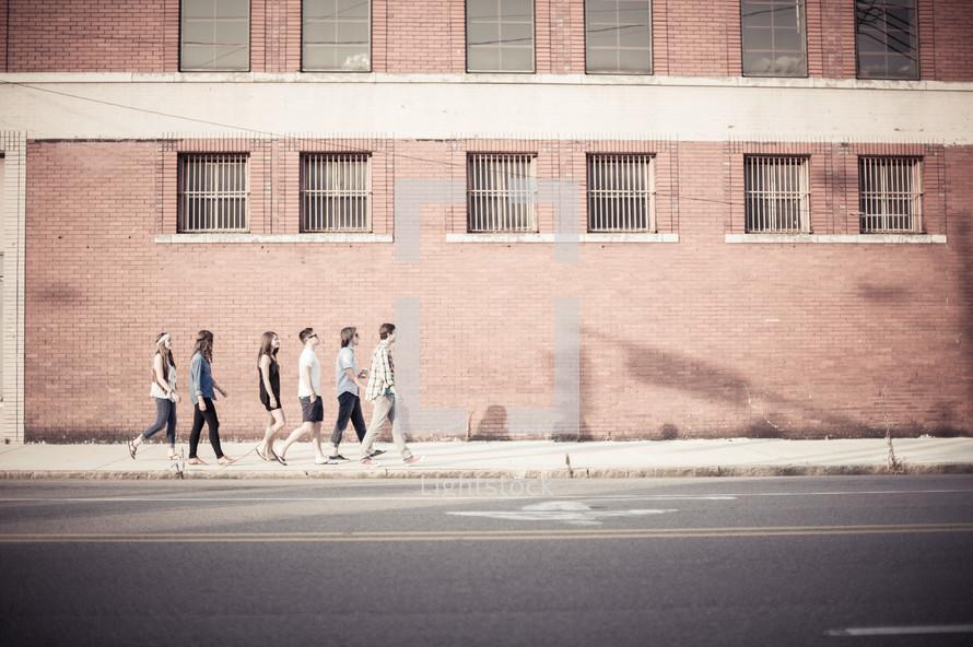 youth walking on a sidewalk