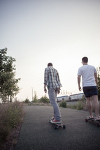teen boys on skateboards on a sidewalk
