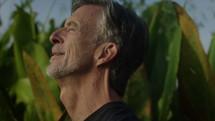 a man feeling warm sunlight on his face