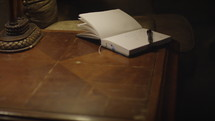 journal opened on a side table