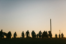 silhouette of a crowd of people walking outdoors