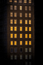 sunlight in the windows of an apartment building