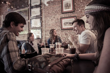 friends in conversation at a coffee shop