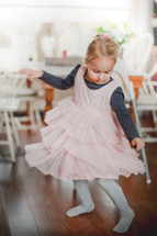 a girl child dancing in a dress