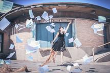 woman throwing sheet music