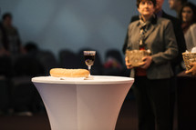 communion bread and wine during a worship service
