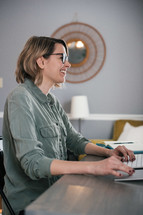 a woman sitting behind a computer working