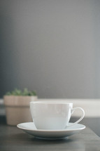 tea cup and saucer on a desk