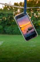 cellphone on a clothesline