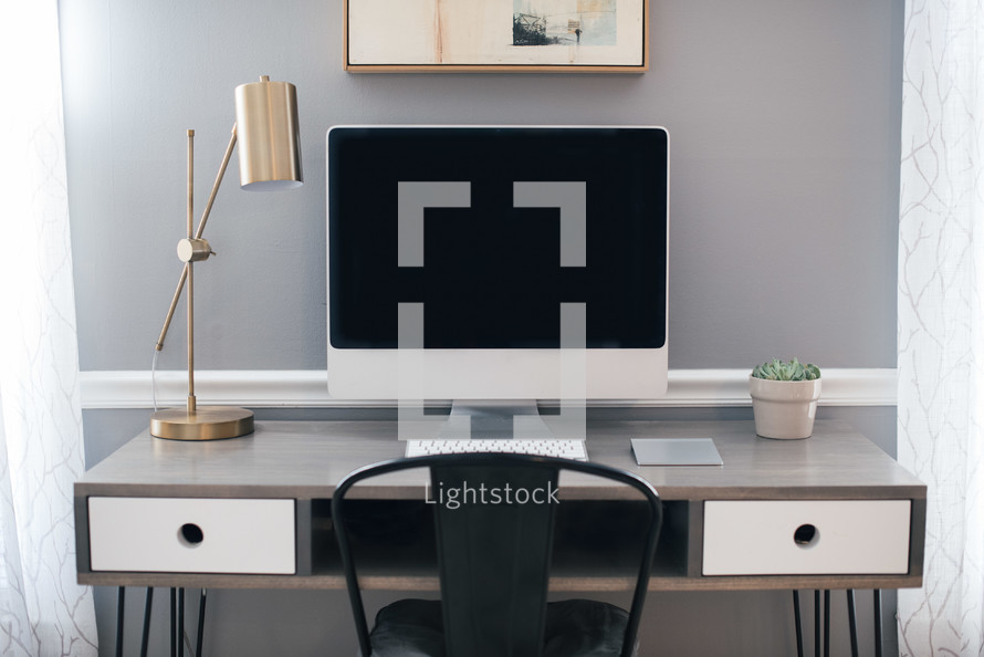 a computer desk in a home office