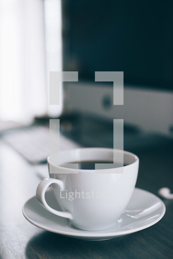 a coffee cup on a desk