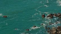 Ocean waves crashing against the rocks.