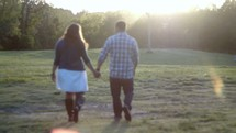 a couple walking holding hands outdoors