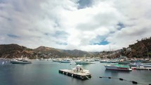 Timelapse of cloud movements over boats in the  bay.