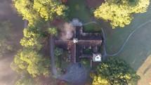 aerial view over a rural mountain church