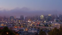 Long day-to-night timelapse of downtown San Francisco with fog rolling in.