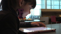 girl scrolling through a tablet