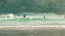 Surfers in the ocean waves.