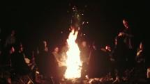 sitting around a campfire