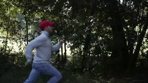 man running through a forest