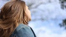 woman breathing in the fresh air