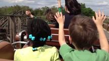 children on a roller coaster