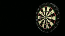 three darts and a dart board