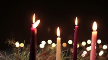 Advent candles lit on an Advent wreath - 2 Shots
