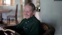 Man praying and reading the BIble.