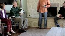Adult Bible study in a home.