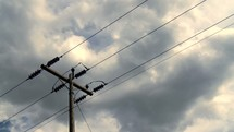power pole and moving clouds