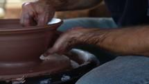 man at a potters wheel