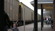 Father and son at a train depot.