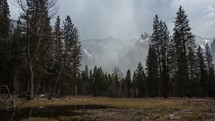 Timelapse of snow blowing across the mountains.
