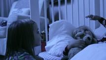 Sisters talking at bedtime.
