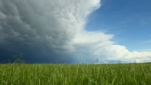 storm clouds approaching over a field