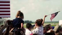 children waving American flags