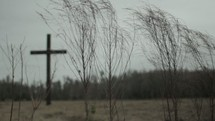 Cross outside in a grassy field.