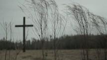 Cross outside in a grassy field.