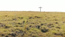 cross on the top of a hill
