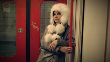 woman on the subway in a furry hat