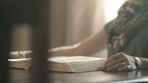 woman sitting down to read a Bible
