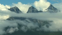 clouds moving over three sisters mountain peaks
